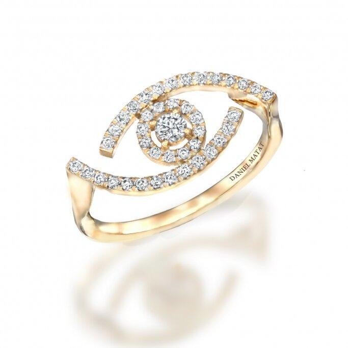 טבעת עין עדי זהב וזרקונים